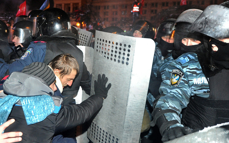 . Anti-Yanukovych protesters clash with anti-riot police on Independence Square in Kiev, early on December 11, 2013. Ukrainian security forces pulled out of the epicentre of mass protests in Kiev today after a nine hour standoff with thousands of demonstrators, in a major boost for the opposition to President Viktor Yanukovych. VIKTOR DRACHEV/AFP/Getty Images