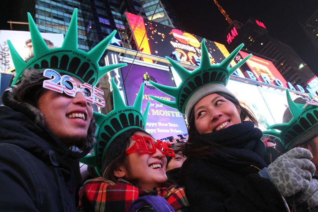 . Yuko Yamagata, right, from Osaka, Japan, and other revelers take part in the New Year\'s Eve festivities Wednesday Dec. 31, 2014, in New York\'s Times Square. (AP Photo/Tina Fineberg)