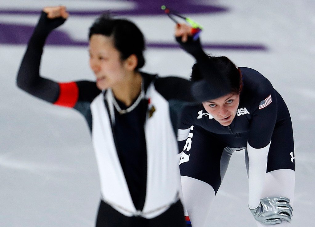 . Heather Bergsma of the U.S., right, appears dejected while silver medallist Miho Takagi of Japan celebrates after the women\'s 1,500 meters speedskating race at the Gangneung Oval at the 2018 Winter Olympics in Gangneung, South Korea, Monday, Feb. 12, 2018. (AP Photo/John Locher)