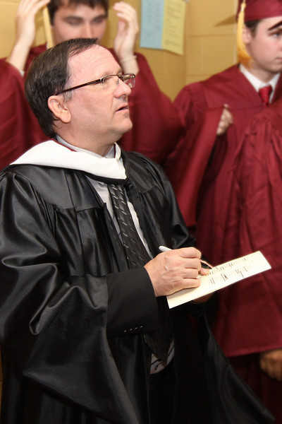 Mr. Joseph Lechner, Head of High School, prepares the Class of 2011 for the Commencement ceremony.