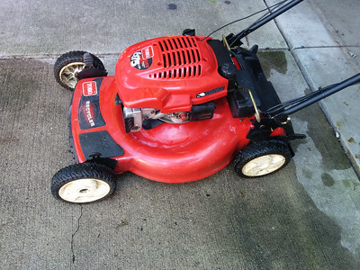 Detailing and tuning up Brad's Toro Lawnmower for sale