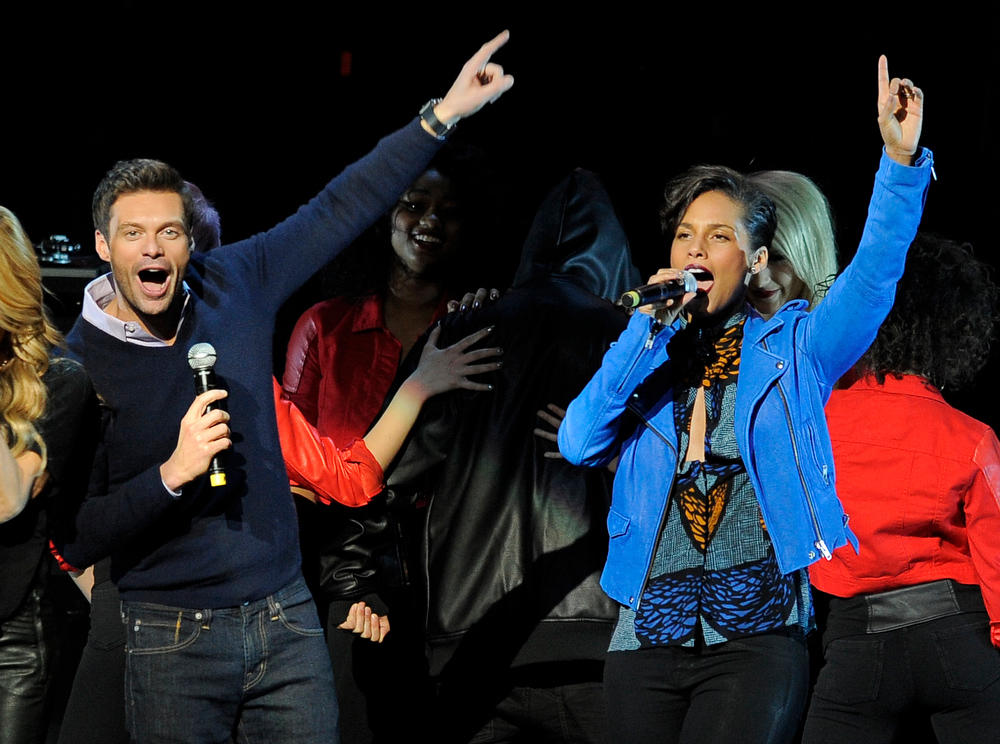 Description of . Ryan Seacrest, left, and singer Alicia Keys introduce Justin Bieber during the second night of KIIS FM's Jingle Ball at Nokia Theatre LA Live on Monday, Dec. 3, 2012, in Los Angeles. (Photo by Chris Pizzello/Invision/AP)