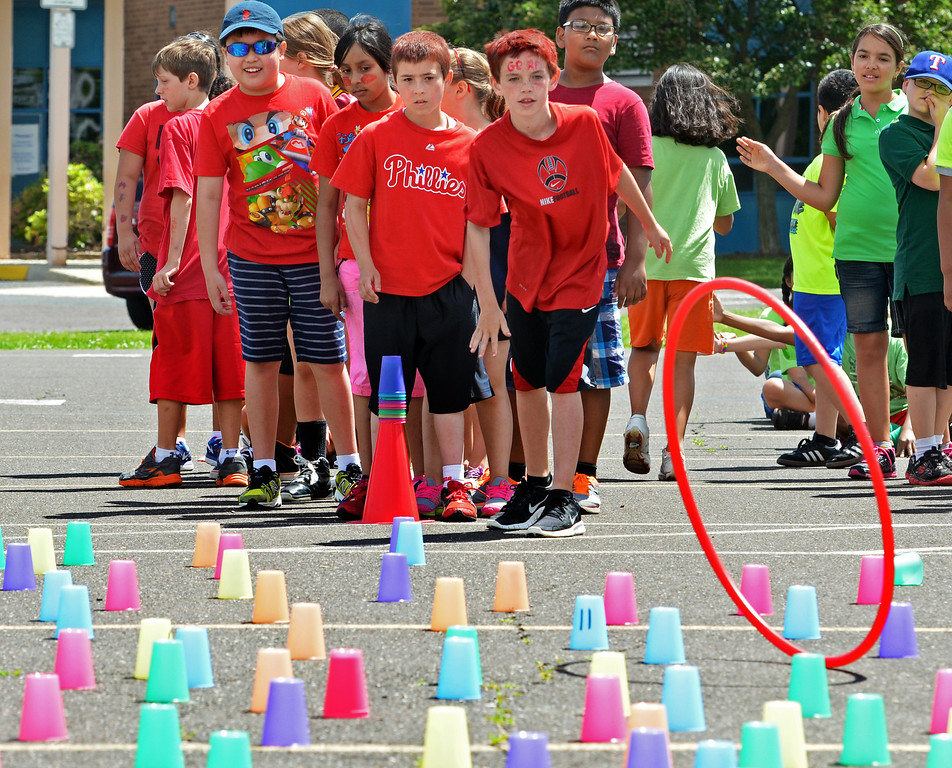. Fourth graders play candyland, one of the Olympics Day games at Hatfield Elementary School.   Friday, June 6, 2014.   Photo by Geoff Patton