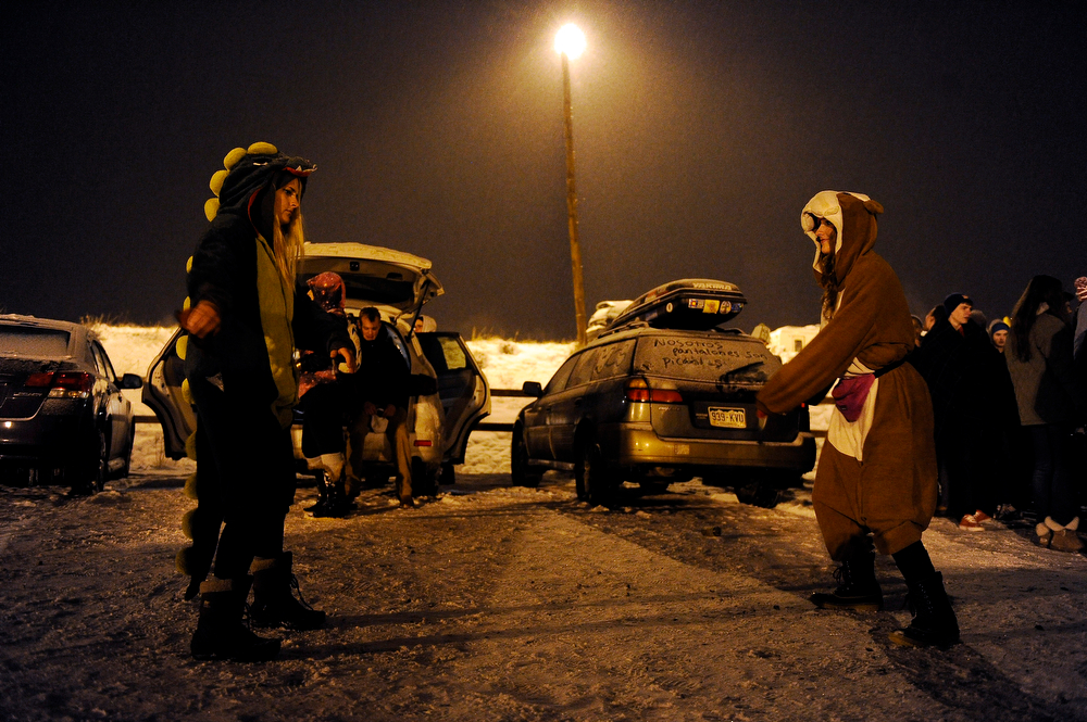 . Victoria Danner, of Chicago, Illinois, left, Katie Bowman, of Austin, Texas dance in the parking lot as they tail gate before Winter on the Rocks at Red Rocks Amphitheatre on January 31, 2014 in Morrison, Colorado. (Photo by Seth McConnell/The Denver Post)