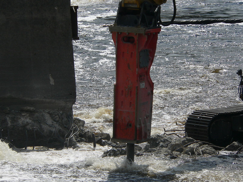NPK GH23 hydraulic hammer on CAT excavator Maine Dam Demolition (32).JPG