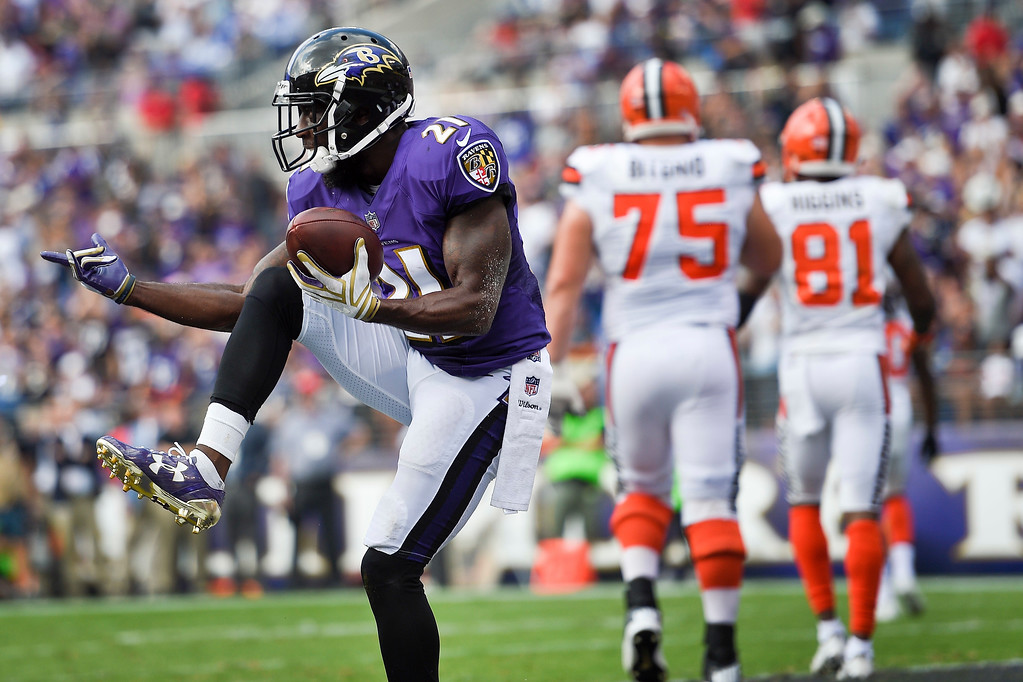 . Baltimore Ravens free safety Lardarius Webb (21) celebrates his interception of a pass intended for Cleveland Browns Rashard Higgins (81) during the second half of an NFL football game in Baltimore, Sunday, Sept. 17, 2017. (AP Photo/Nick Wass)
