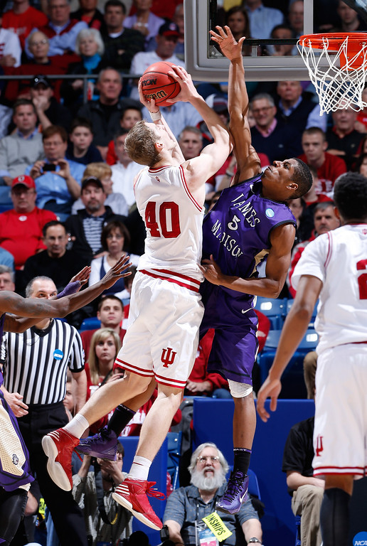 . DAYTON, OH - MARCH 22: Cody Zeller #40 of the Indiana Hoosiers drives to the basket against Alioune Diouf #5 of the James Madison Dukes in the first half during the second round of the 2013 NCAA Men\'s Basketball Tournament at UD Arena on March 22, 2013 in Dayton, Ohio.  (Photo by Joe Robbins/Getty Images)