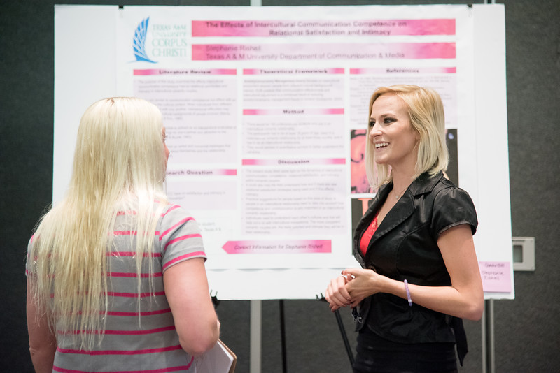 Stephanie Rishell speaks to Brooke Friley during the Communication's department Poster Presentations.