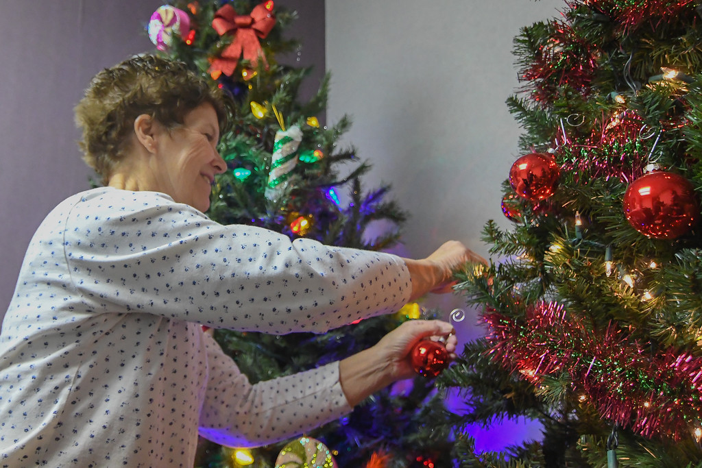 ". Volunteer Jean Karnik, of Lorain, decorates one of three Christmas trees on display in Santa\'s story room at Santa�s Story Land Christmas, 453 Broadway Ave., Nov. 21, 2016. The interactive holiday attraction kicks off from 5 to 9 p.m. Nov. 26, during Lorain\'s Waterfront Winterfest and continues from 3 to 7 p.m. Nov. 27. The event will then continue from 3 to 7 p.m. each Saturday and Sunday, through Dec. 18. For more information, visit <a href=""http://lorainwinterfest.com/santas-storyland/\"">lorainwinterfest.com/santas-storyland</a>. (Eric Bonzar � The Morning Journal)"