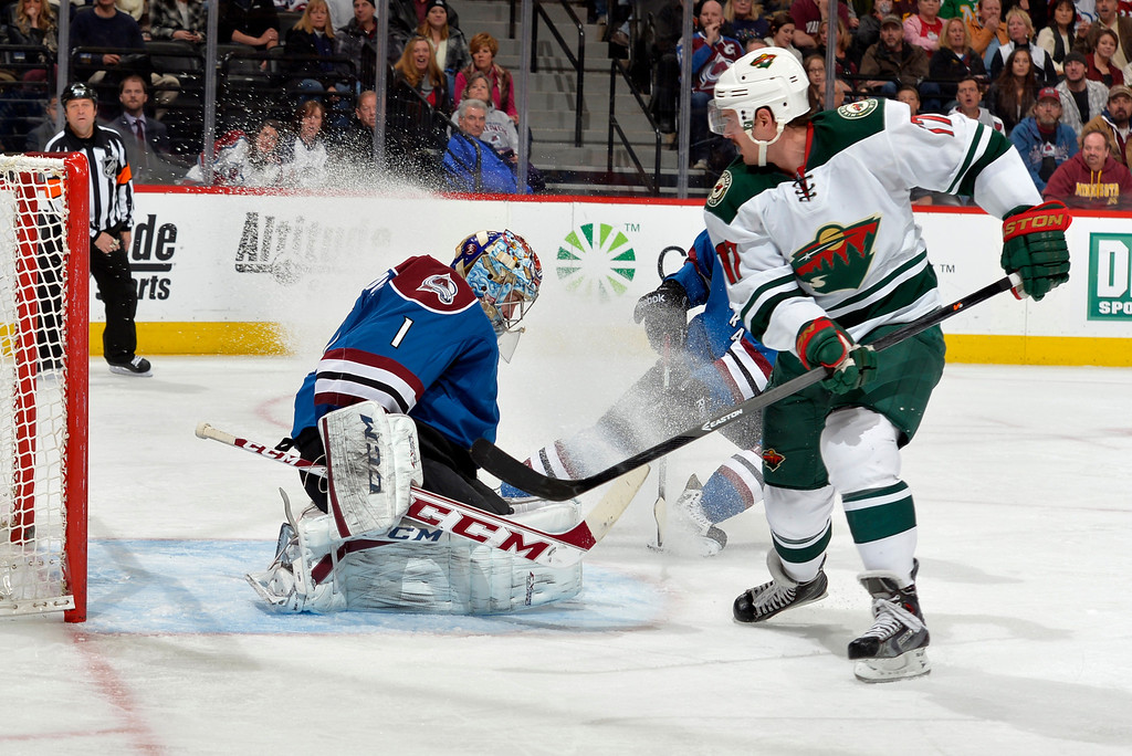 . Colorado Avalanche goalie Semyon Varlamov (1) from Russia blocks a shot by Minnesota Wild center Torrey Mitchell (17) during the second period of an NHL hockey game Saturday, Nov. 30, 2013, in Denver. (AP Photo/Jack Dempsey)