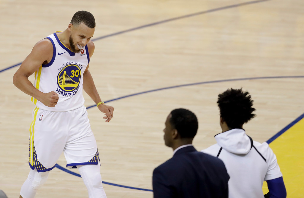 . Golden State Warriors guard Stephen Curry celebrates during the second half of Game 1 of basketball\'s NBA Finals between the Warriors and the Cleveland Cavaliers in Oakland, Calif., Thursday, May 31, 2018. (AP Photo/Marcio Jose Sanchez)