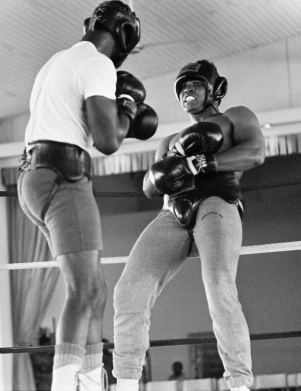 . Muhammad Ali, right,  boxes with sparring partner Larry Holmes during his first workout at the N\'Sele , Zaire training camp Wednesday , September 11, 1974 in preparation for his Sept. 24.   Title bout with heavyweight champion George Foreman.   Ali boxed six rounds. The September match was rescheduled for October 29, 1974 to allow George Foreman to recover from an eye injury.     (AP Photo/Horst Faas)