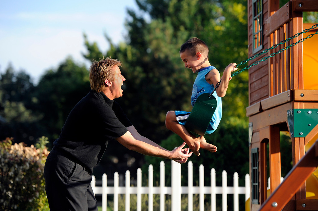 . Lori Moriarty tickles Santos, 5,  while playing on the swing outside their home in Jefferson County, Wednesday, July 11, 2012. Craig F. Walker, The Denver Post