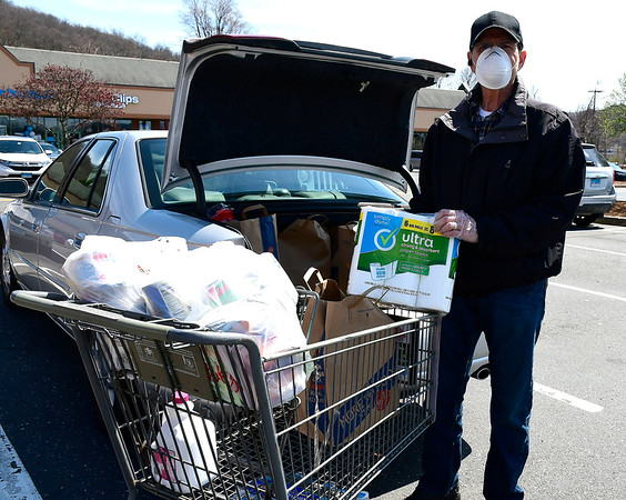 4/7/2020 Mike Orazzi | StaffrRoger Thorin while shopping at the Big Y in Plainville on Tuesday.