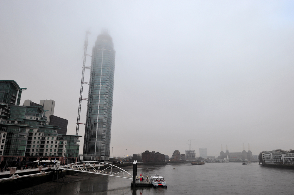 Description of . A pictures shows The Tower at St George Wharf development after a helicopter hit a crane at the construction site of the apartment block in central London on January 16, 2013. Two people were killed after a helicopter hit a crane at a building site and plunged to the ground in a ball of flames, police said.   CARL COURT/AFP/Getty Images