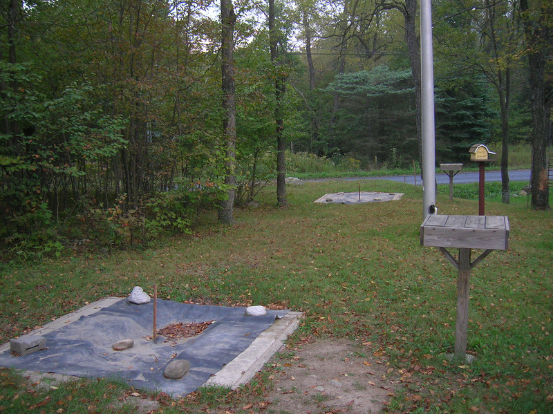 Lighted horseshoe pits with drink tables