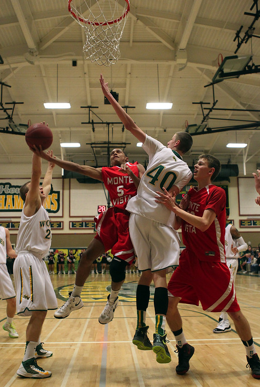 . Monte Vista\'s Grant Jackson (5) shoots the ball against San Ramon Valley\'s David Gunn (40) in the first half of their varsity boys basketball game in Danville, Calif., on Friday, Feb. 15, 2013. (Anda Chu/Staff)