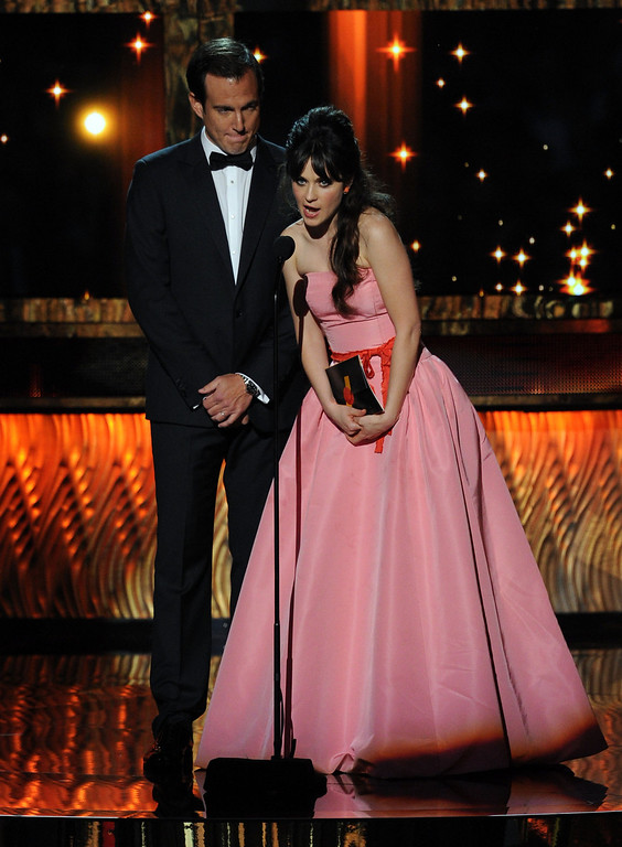 . Actors Will Arnett (L) and Zooey Deschanel speak onstage during the 63rd Annual Primetime Emmy Awards held at Nokia Theatre L.A. LIVE on September 18, 2011 in Los Angeles, California.  (Photo by Kevin Winter/Getty Images)