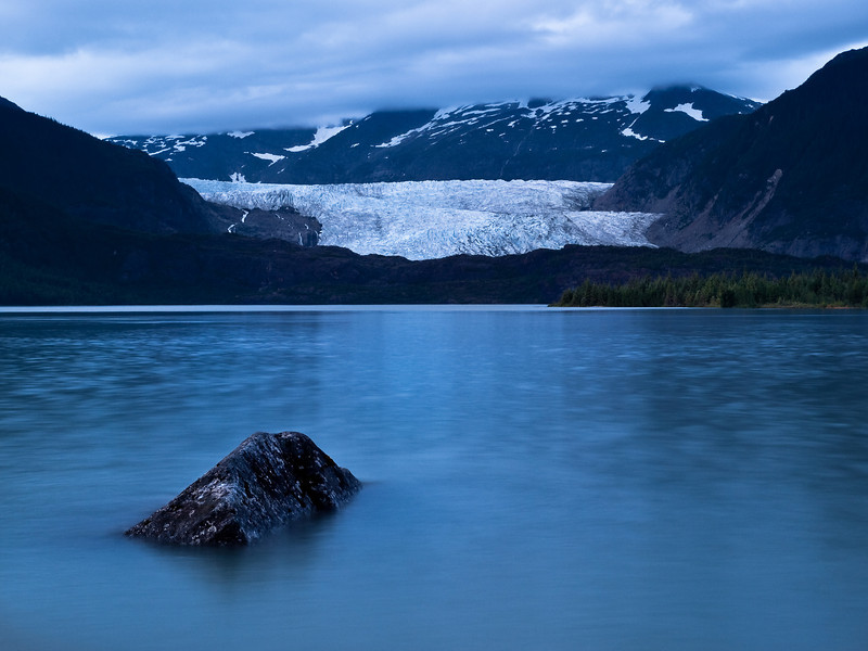A four second exposure allowed me to still the lake and capture this late evening shot at the glacier. Only the mosquitoes were a problem.  July 31, 2009.