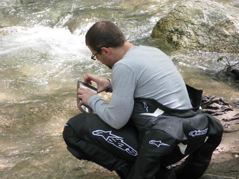 Erik washing up in the river