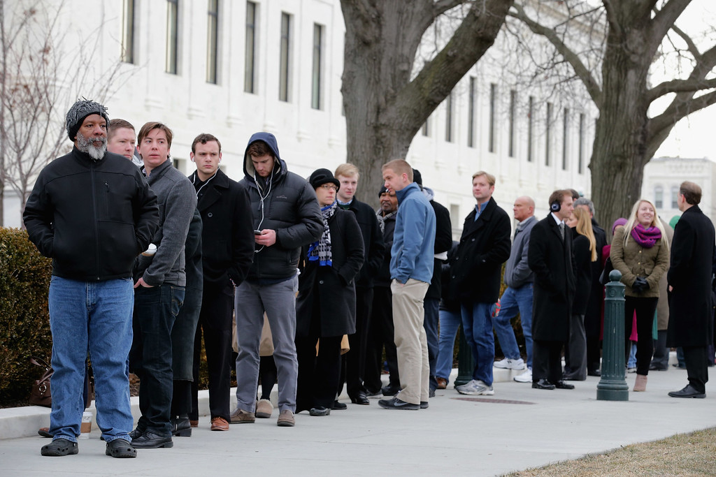 . Members of the public line up to pay their respects to U.S. Supreme Court Associate Justice Antonin Scalia outside the court building February 19, 2016 in Washington, DC. Justice Scalia, who died unexpectedly last week, will lie in repose in the Great Hall of the high court where visitors will pay their respects.  (Photo by Chip Somodevilla/Getty Images)