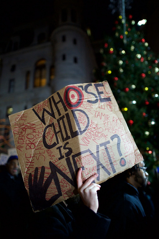 . Demonstrators gather in Philadelphia to protest the Eric Garner grand jury decision during a Christmas Tree lighting ceremony at City Hall December 3, 2014 in Philadelphia, Pennsylvania. Organizers called for the demonstration after a grand jury in the Staten Island borough of New York City declined to indict the police officer who used a chokehold on Garner, resulting in his death. (Photo by Mark Makela/Getty Images)