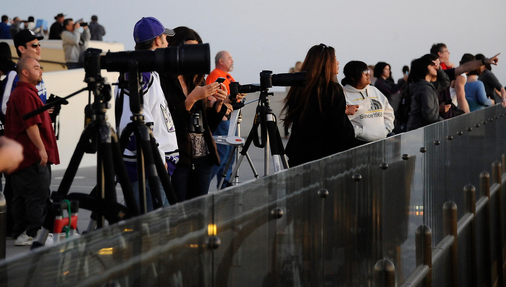 . People gather to view the comet Pan-STARRS from the Griffith Park Observatory.