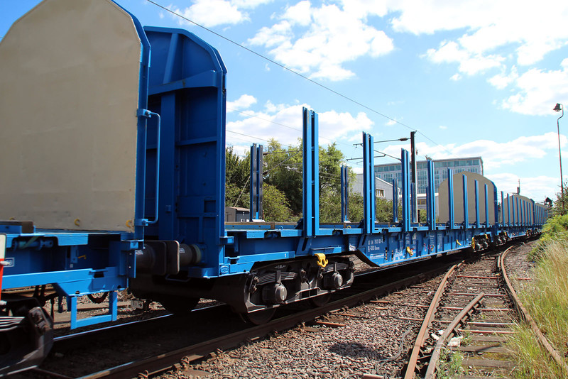 New Colas Log Wagon IWA 83.84.3523031-6 on 6z47 Dollands Moor-Gloucester passing Mitre Bridge Jct 31/08/12.