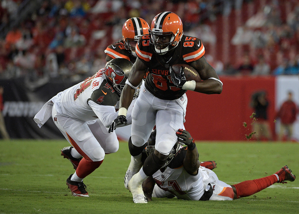 . Cleveland Browns tight end David Njoku (85) slip a tackle by Tampa Bay Buccaneers defensive end Robert Ayers (91) during the third quarter of an NFL preseason football game Saturday, Aug. 26, 2017, in Tampa, Fla. (AP Photo/Phelan Ebenhack)