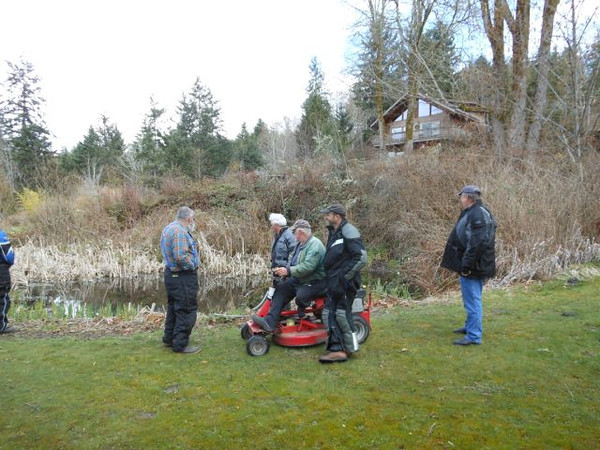 20120401 Ray Rides His Mobility Mower.jpg