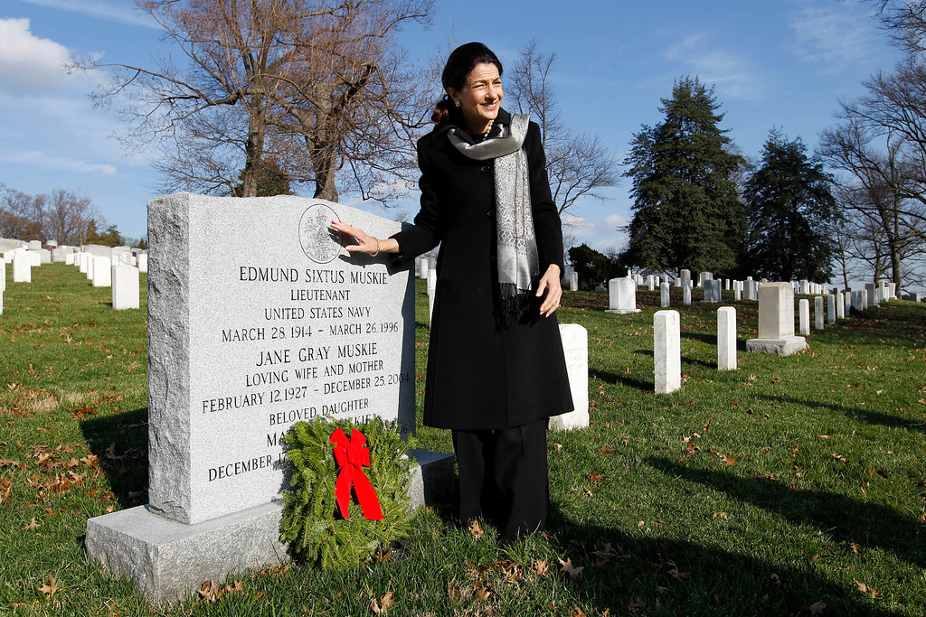 . Sen. Olympia Snowe R-Maine lays a holiday wreaths over the grave of Lieutenant Edmund Sixtus Muskie at Arlington National Cemetery in Washington Saturday Dec. 10, 2011, during Wreaths Across America Day. Muskie was a former Maine governor, a U.S. Senator, and Secretary of State under President Jimmy Carter from 1980 to 1981. (AP Photo/Jose Luis Magana)