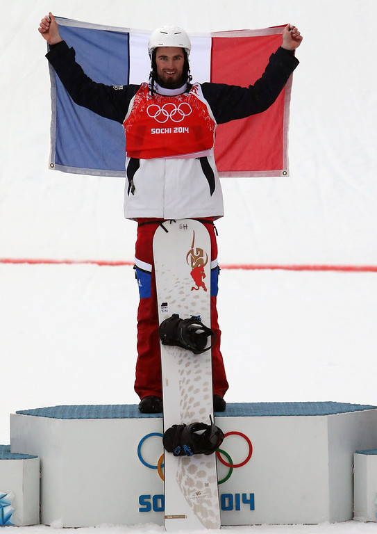 . Pierre Vaultier of France celebrates winning the gold medal during the Snowboarding Men\'s Snowboard Cross at the Rosa Khutor Extreme Park on February 18, 2014 in Sochi, Russia. (Photo by Christophe Pallot/Agence Zoom/Getty Images)