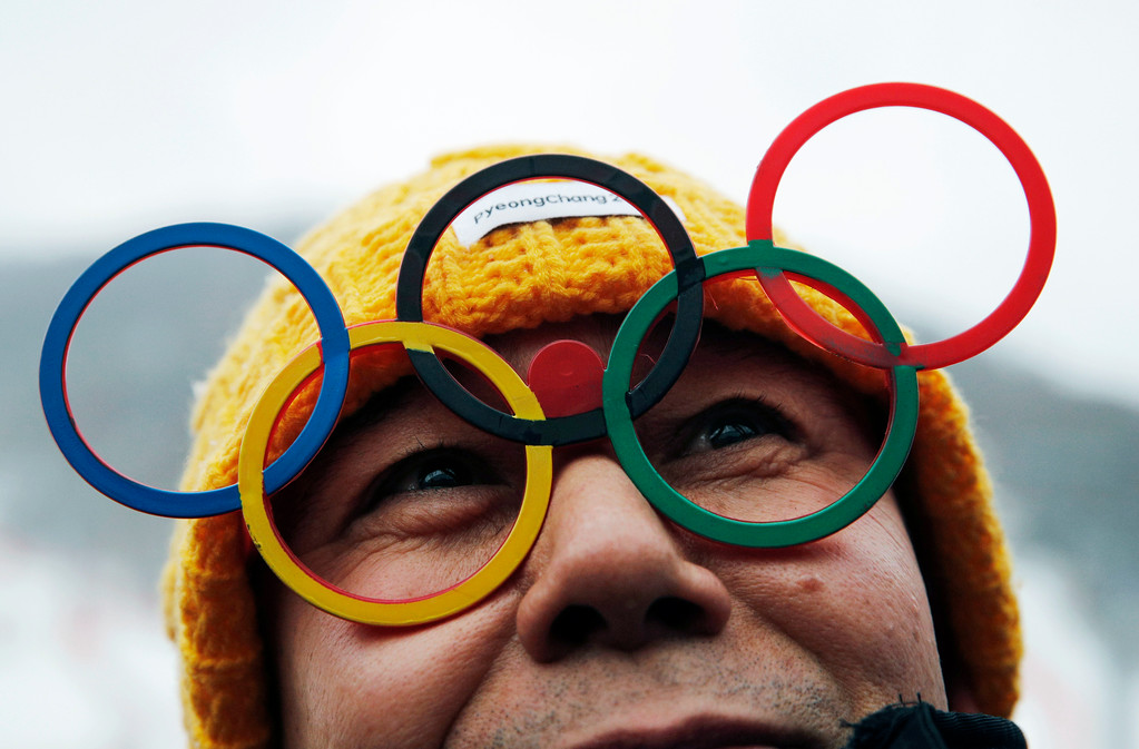 . A spectator wears glasses of the Olympic rings at the women\'s slalom at Yongpyong Alpine Center at the 2018 Winter Olympics in Pyeongchang, South Korea, Wednesday, Feb. 14, 2018. (AP Photo/Christophe Ena)