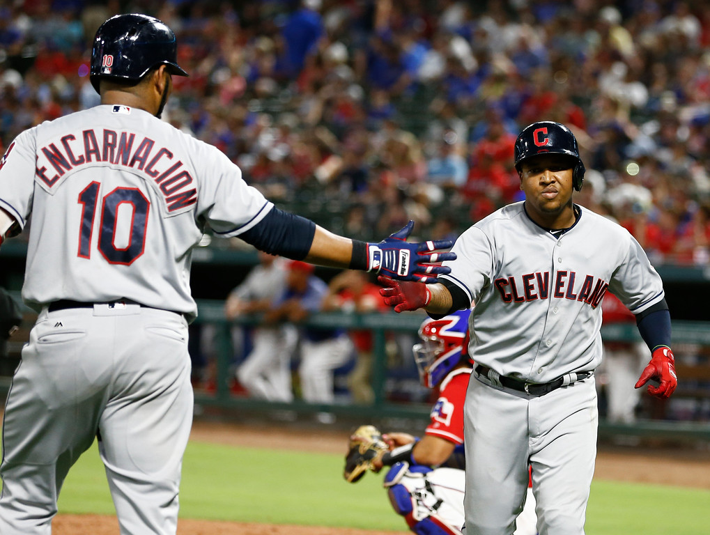 . Cleveland Indians\' Jose Ramirez, right, celebrates his solo home run with Edwin Encarnacion (10) against the Texas Rangers during the sixth inning of a baseball game, Friday, July 20, 2018, in Arlington, Texas. (AP Photo/Jim Cowsert)