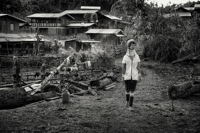 A Kayan lady walking through her village.  Kayah State, Myanmar.