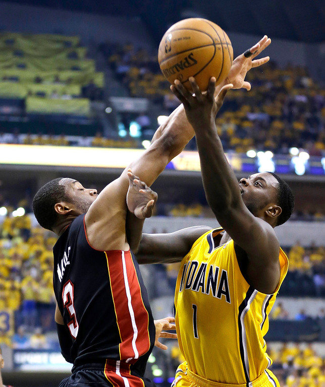 . Indiana Pacers\' Lance Stephenson shoots against Miami Heat\'s Dwyane Wade during the second half of Game 2 of the NBA basketball Eastern Conference finals in Indianapolis, Tuesday, May 20, 2014. (AP Photo/Michael Conroy)
