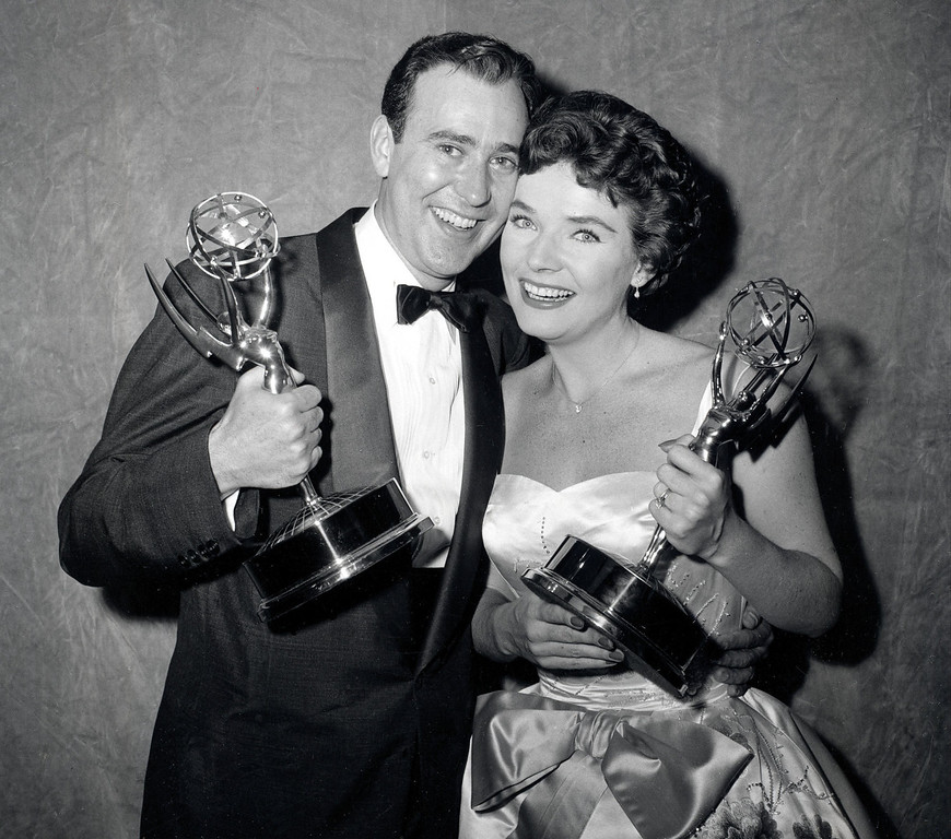 """. Writer Carl Reiner and actress Polly Bergen pose with their statuettes at the Emmy Awards presentations in New York City, April 15, 1958.  Reiner won for best continuing supporting performance by an actor in a dramatic or comedy series for \""""Caesar\'s Hour.\""""  Bergen won best single performance by an actress in a lead or support role for \""""Playhouse 90:  Helen Morgan Story.\""""  (AP Photo)"""