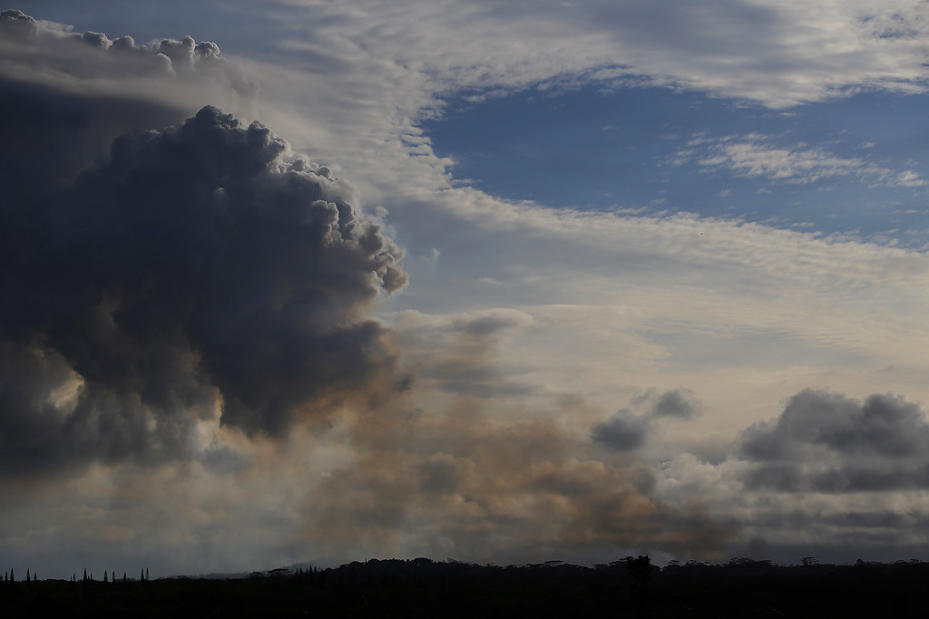 . Smoke and volcanic gases rise from the Leilani Estates, Sunday, May 6, 2018, near Pahoa, Hawaii. Scientists reported lava spewing more than 200 feet (61 meters) into the air in Hawaii\'s recent Kilauea volcanic eruption, and some of the more than 1,700 people who evacuated prepared for the possibility they may not return for quite some time. (AP Photo/Marco Garcia)