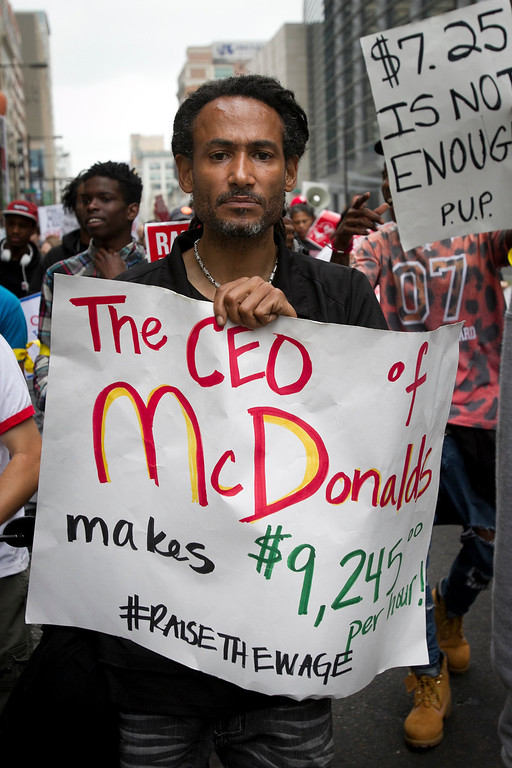. Glenn Davis marches with about 100 other protesters and fast food workers demanding a wage increase during a demonstration in front of a McDonalds restaurant in Philadelphia on Thursday morning May 15, 2014. (AP Photo/Philadelphia Daily News, Alejandro A. Alvarez)