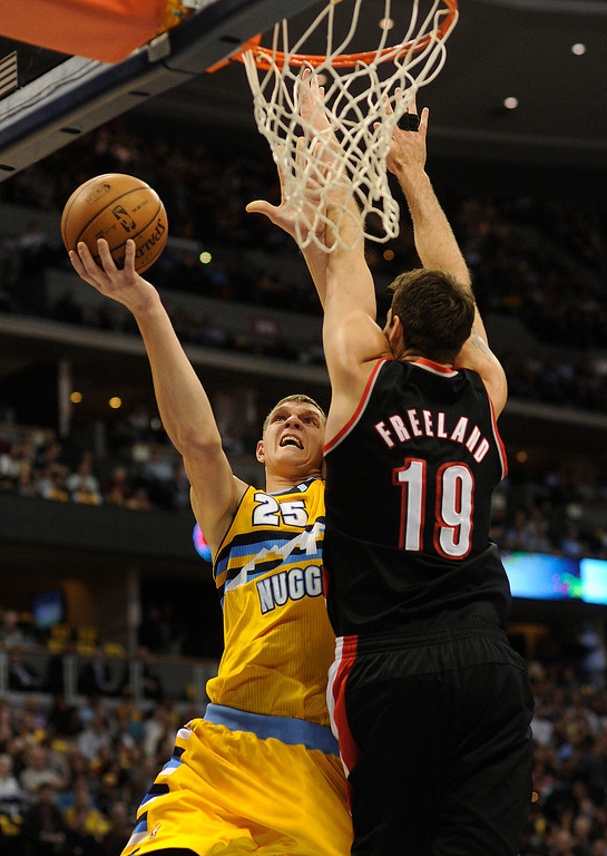 . DENVER, CO. - NOVEMBER 1:  Denver center Timofey Mozgov (25) tried to wrap a shot around Portland defender Joel Freeland (19) in the first half. The Denver Nuggets hosted the Portland Trail Blazers Friday night, November 1, 2013 at the Pepsi Center.  Photo By Karl Gehring/The Denver Post