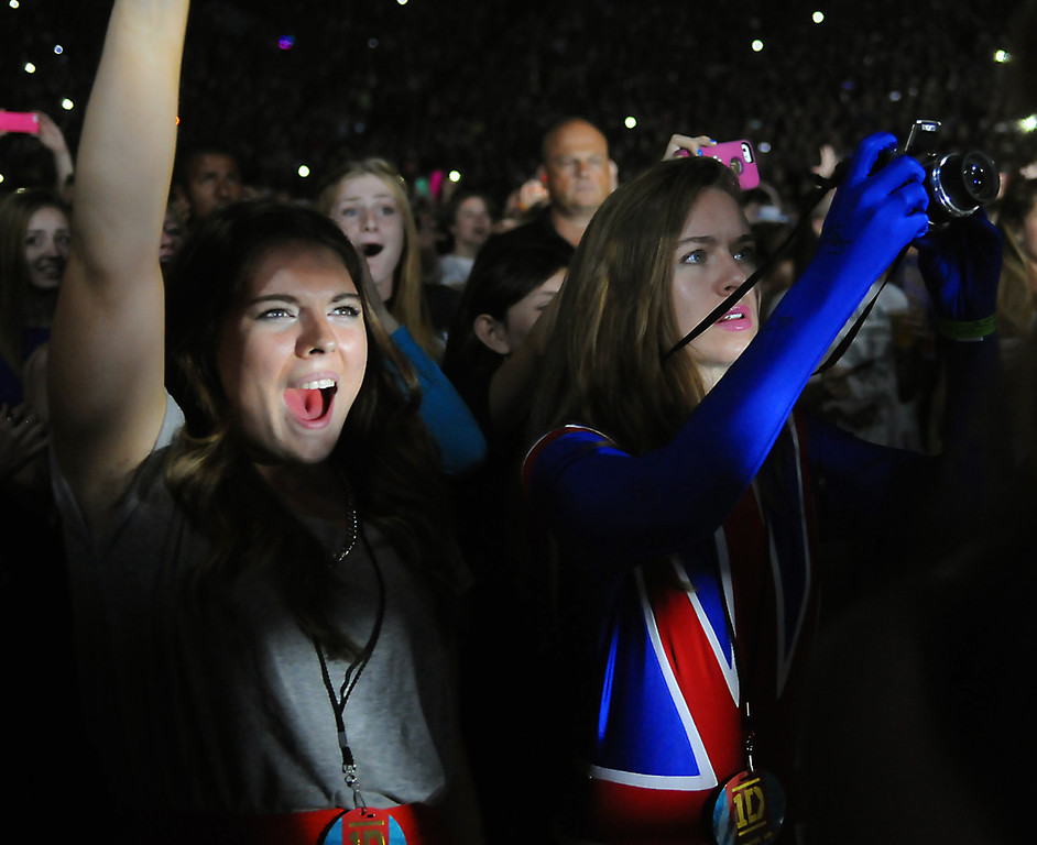 . Two young fans, one dressed in the Union Jack cheer during the opening of the One Direction concert at the Target Center, in Minneapolis, Thursday, July 18, 2013.  (Pioneer Press: John Autey)