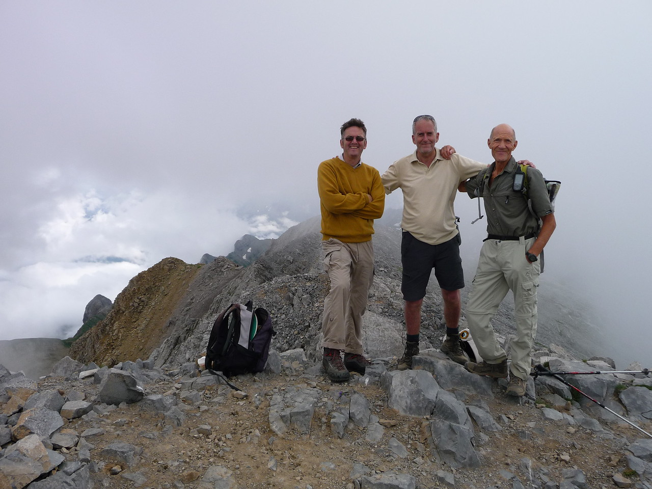 Gareth, Edward and Vic on the cloudy summit of Bisaurin 2668m
