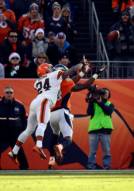 . Denver Broncos wide receiver Demaryius Thomas (88) pulls in the first touchdown of the game against Cleveland Browns cornerback Sheldon Brown (24) in the first quarter.  The Denver Broncos vs Cleveland Browns at Sports Authority Field Sunday December 23, 2012. John Leyba, The Denver Post