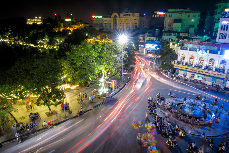 Busy colorful Old Hanoi by night.