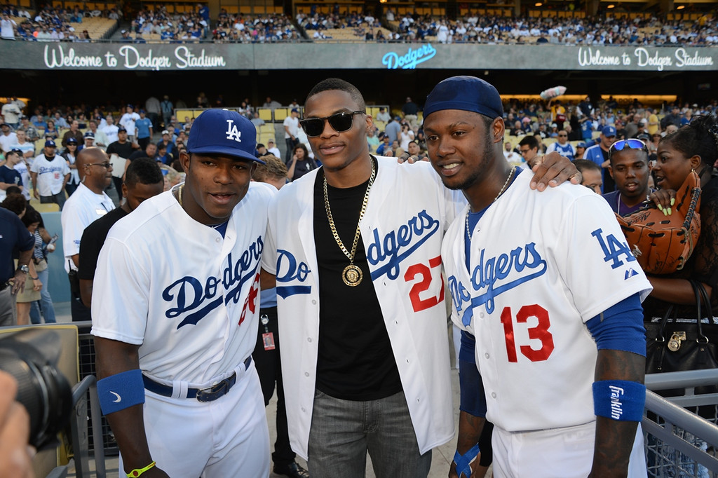 . (L-R) Dodgers player Yasiel Puig, NBA player Russell Westbrook and Dodgers player Hanley Ramirez attend a game between the Los Angeles Dodgers and the New York Yankees on July 30, 2013 at Dodger Stadium in Los Angeles, Caifornia. (Photo by Jon Soohoo/Los Angeles Dodgers via Getty Images)