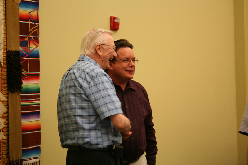 Fr. Mike Burke congratulates Fr. Jack Kurps on his election.
