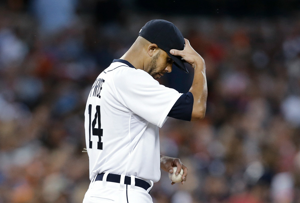 . Detroit Tigers pitcher David Price reacts in the third inning of a baseball game against the New York Yankees in Detroit, Wednesday, Aug. 27, 2014. Price allowed eight earned runs in two innings. (AP Photo/Paul Sancya)