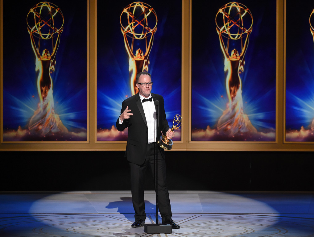 ". Nick Murray accepts the award for outstanding directing for a reality program for ""RuPaul\'s Drag Race - 10s Across the Board\"" during night two of the Television Academy\'s 2018 Creative Arts Emmy Awards at the Microsoft Theater on Sunday, Sept. 9, 2018, in Los Angeles. (Photo by Phil McCarten/Invision/AP)"