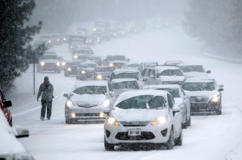 . Traffic crawls along Hammond Road during a winter storm Wednesday Feb. 12, 2014, in Durham, N.C. (AP Photo/The News & Observer, Travis Long)