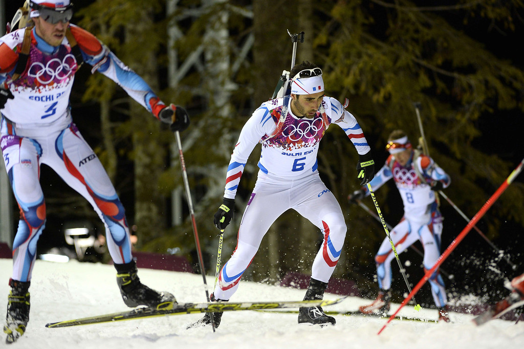 . From left to right Czech Republic\'s Jaroslav Soukup, France\'s Martin Fourcade and Czech Republic\'s Ondrej Moravec compete in the Men\'s Biathlon 12,5 km Pursuit at the Laura Cross-Country Ski and Biathlon Center during the Sochi Winter Olympics on February 10, 2014 in Rosa Khutor near Sochi. Fourcade won gold and Moravec the silver medal.  PIERRE-PHILIPPE MARCOU/AFP/Getty Images